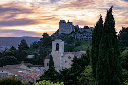 View on traditional medieval houses and castle ruines in Provence during sunrise, South of France, vacation and tourist destination
