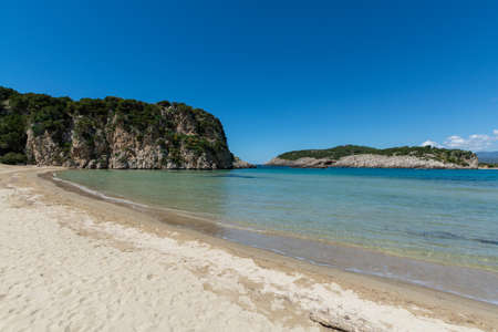 Voidokilia Beach, popular white sand and blue clear water beach in Messinia in Mediterranean area in shape of Greek letter omega, Peloponnese, Greece, vacation destination