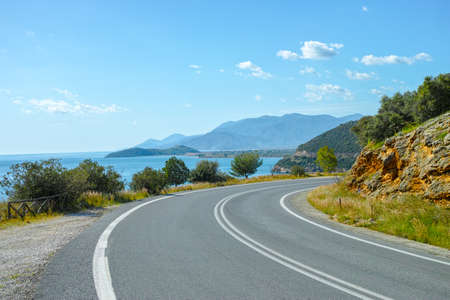 Driving car on roads of Peloponnese, roads network in Greece, vacation and tourist destination