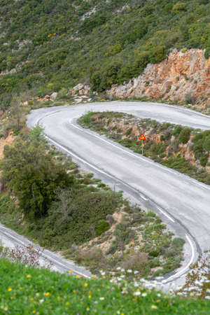 Driving car on S shape winding roads of Peloponnese, roads network in Greece, vacation and tourist destination Imagens