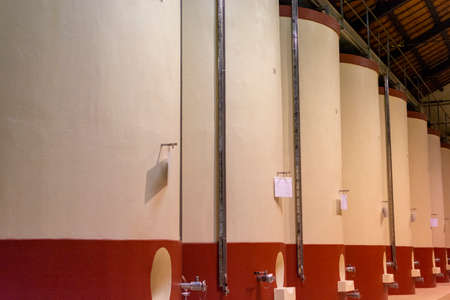 Modern wine production in Italy, concrete tanks for wine fermentation close up