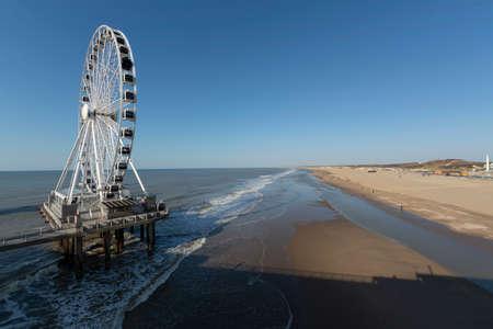 Sunny day on North sea beach in Netherlands in Schegeningen, tourist and vacation destination in Europe