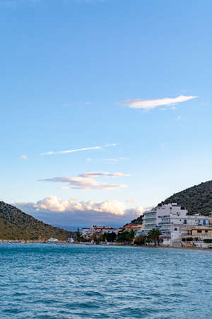 Small town Tolo, located near Nafplio in cozy sea bay with clear water and fine sand, summer vacation destination for families with kids, Peloponnese, Greece
