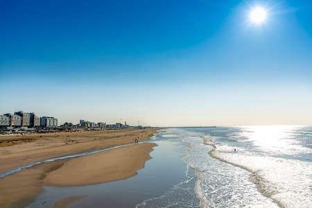Sunny day on North sea beach in Netherlands near Schegeningen, tourist and vacation destination in Europe