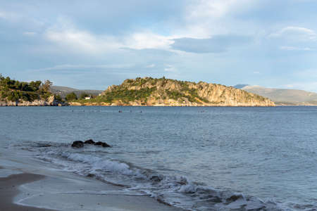 Sea bay in small town Tolo, located near Nafplio with clear water and fine sand, summer vacation destination for families with kids, Peloponnese, Greece