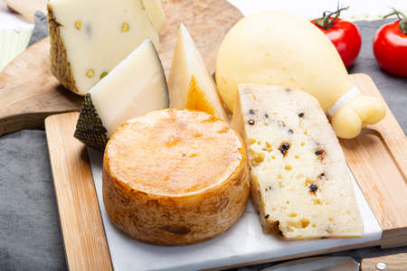 Cheese collection, Variety of Italian pecorino and provolone cheeses, aged with black peppers from Nebrodi, white Il Palio and black molarotto, close up Stockfoto