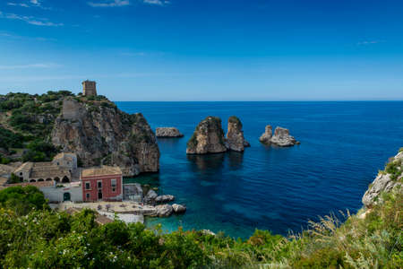 Scenic coastline with rocks and deep blue sea near Castellamare del Golfo by entrance to natural reserve Zingaro, Sicily, Italy