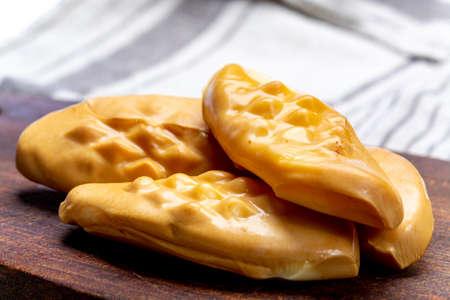 Oscypek or Oszczypek smoked cheese made of salted sheep milk exclusively in Tatra Mountains, Zakopane, Poland, close up