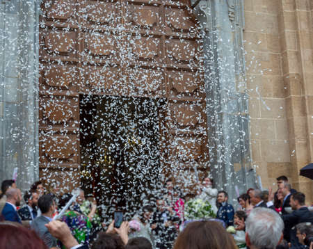 May 25, 2019, Marsala, Italy, Italian catholic wedding in church with many happy guests and salute from papers and rice Stock fotó