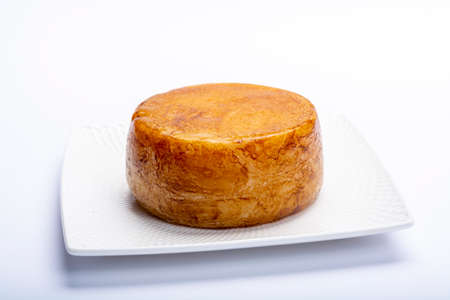 Hard Italian pecorino sheep cheese in one piece close up isolated
