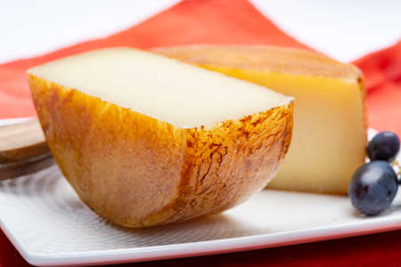 Hard Italian pecorino sheep cheese in two pieces close up isolated