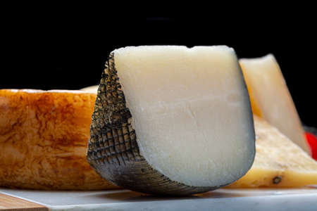 Cheese collection, Variety of Italian pecorino cheeses, aged with black peppers from Nebrodi, white Il Palio and black molarotto, close up