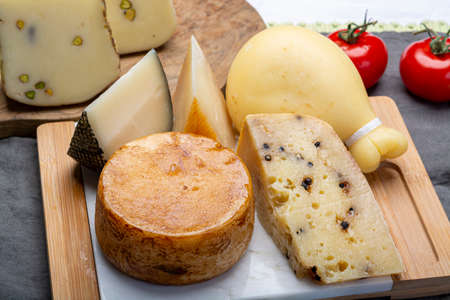 Cheese collection, Variety of Italian pecorino and provolone cheeses, aged with black peppers from Nebrodi, white Il Palio and black molarotto, close up Banco de Imagens
