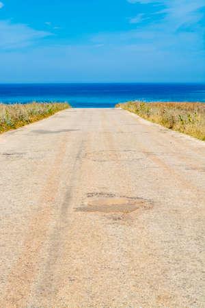Scenic coastal road to wild beach near San Vito lo Capo, Sicily island, Italy