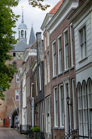 View on old Dutch houses and tower in Zierikzee, historical town in province Zeeland, Netherlands Фото со стока