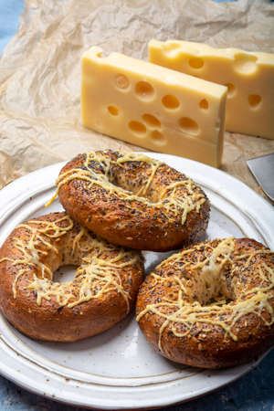 Tasty baked bagels with melted french emmental cheese  close up