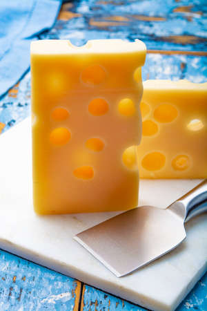 Two blocks of French emmental semi-hard cheese close up Banque d'images