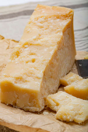 Cheese collection, Piece of Italian original aged Parmesan cheese and cheese knife close up