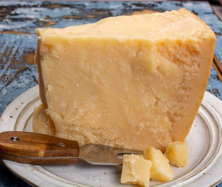 Cheese collection, hard italian cheese, aged parmesan or grana padano cheese close up