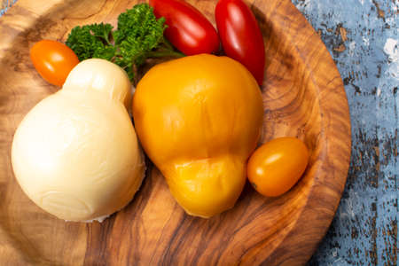 Cheese collection, white and smoked yellow italian scamorza cheese 스톡 콘텐츠