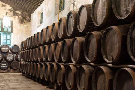 Production of fortified jerez, xeres, sherry wines in old oak barrels in sherry triangle, Jerez la Frontera, El Puerto de Santa Maria and Sanlucar Barrameda Andalusia, Spain