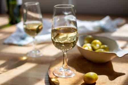 Sherry wine tasting, dry fino jerez fortified wine made from palamino white grapes and olives with garlic, El Puerto de Santa Maria, Andalusia, Spain Reklamní fotografie