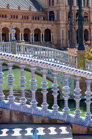 Decoration details of Place of Spain in Seville, traditional Andalucian tails on bridge close up