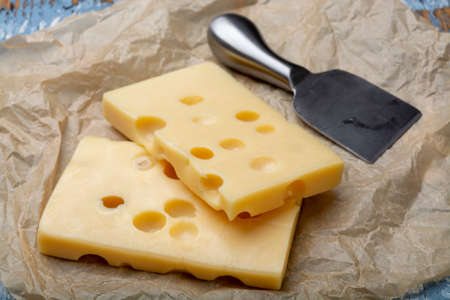 Two blocks of French emmental semi-hard cheese close up 写真素材