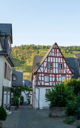 Street in old German town with traditional medieval timber framing houses, Mosel river valley, Germany