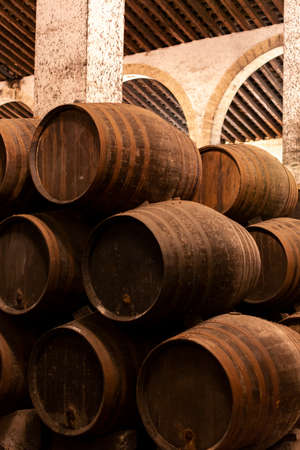 Production of fortified jerez, xeres, sherry wines in old dark oak barrels in sherry triangle, Jerez la Frontera, El Puerto Santa Maria and Sanlucar Barrameda Andalusia, Spain Stock Photo