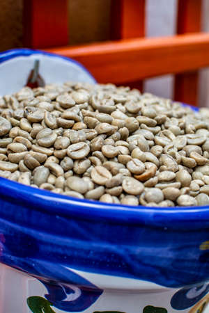 Unroasted decaf green coffee beans without caffeine close up
