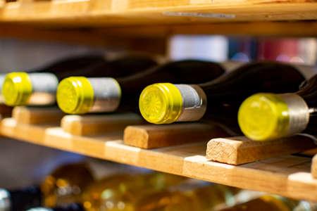Wine bottles storage on wine rack in restaurant close up