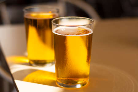 Cold amber color light spanish beer served in glass in outdoor cafe in sunny Andalusia, Spain close up Zdjęcie Seryjne