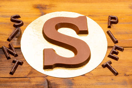Celebration of Saint Nicholas, patron saint of children in Netherlands, Belgium, Luxembourg and North of France in first week of December, chocolate letters S and names of Sint and Piet close up Banco de Imagens