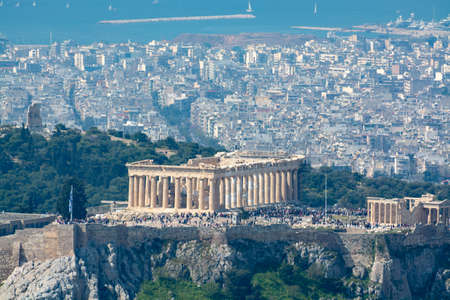 Athens, capital of Greece, in spring, view from hill, cityscape with Acropolis, streets and buildings, ancient urbal culture Standard-Bild
