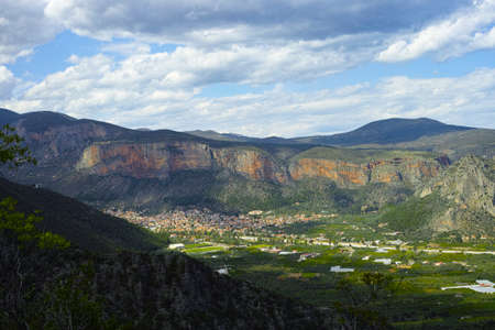 View on fertile valley near Leonidio, Peloponnese, Greece with ancient town, mountains, fields and orchards Reklamní fotografie