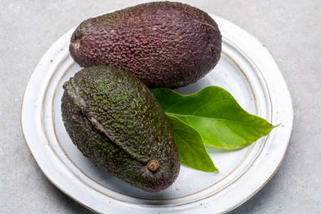 New harvest of fresh ripe hass avocado close up