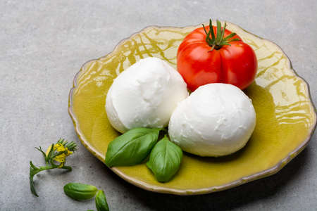 Cheese collection, Italian soft white cheese mozzarella in balls with tomato and basil Stockfoto