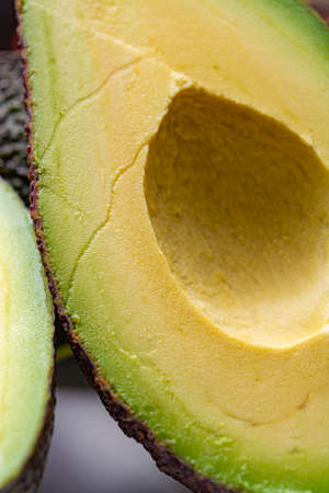 Macro photo, fresh ripe organic hass avocado, cut in half Stock Photo