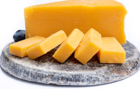 Cheddar cheese collection, piece of yellow Cheddar cheese made from cow milk close up, isolated