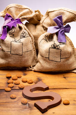 Celebration of Saint Nicholas, patron saint of children in Netherlands, Belgium, Luxembourg and North of France in first week of December, burlap sacks with presents and candy for kids  close up