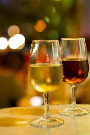 Christmas sherry wine, dry or sweet jerez fortified wine in glasses and street lights, Jerez de la Frontera, Andalusia, Spain close up Stock Photo