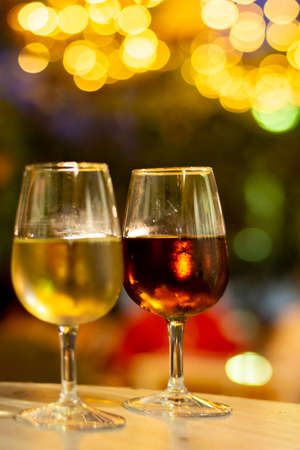 Christmas sherry wine, dry or sweet jerez fortified wine in glasses and street lights, Jerez de la Frontera, Andalusia, Spain close up Stok Fotoğraf