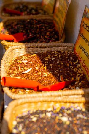 Assortment of herbal aromatic tea blends in tea shop close up Banco de Imagens