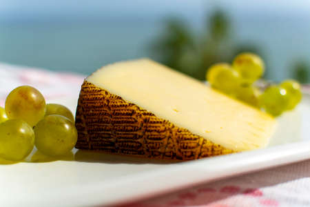 Spanish sheep cheese served with white outside with sea view close up Banco de Imagens