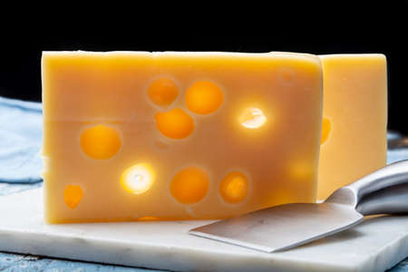 Two blocks of French emmental semi-hard cheese close up Stock Photo