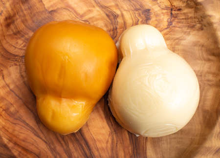 Cheese collection, white and smoked yellow italian scamorza cheese Stock Photo