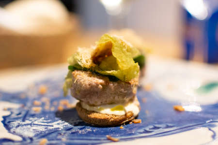 Andalusian gourmet food tapas, small bread with blue tuna fish close up Stock Photo