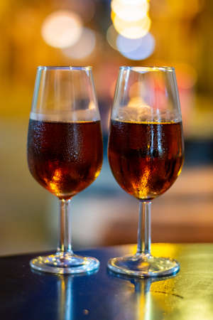 Christmas sherry wine, dry or sweet jerez fortified wine in glasses and street lights, Jerez de la Frontera, Andalusia, Spain close up 스톡 콘텐츠