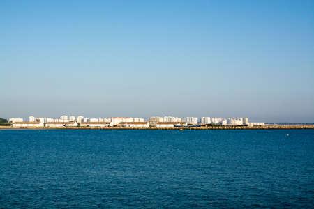 Panoramic view from Atlantic ocean on modern part of El Puerto de Santa Maria, Andalusia, Spain